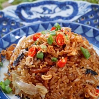 Portrait photo of Cantonese Cabbage and Mushroom Rice on a blue antique plate