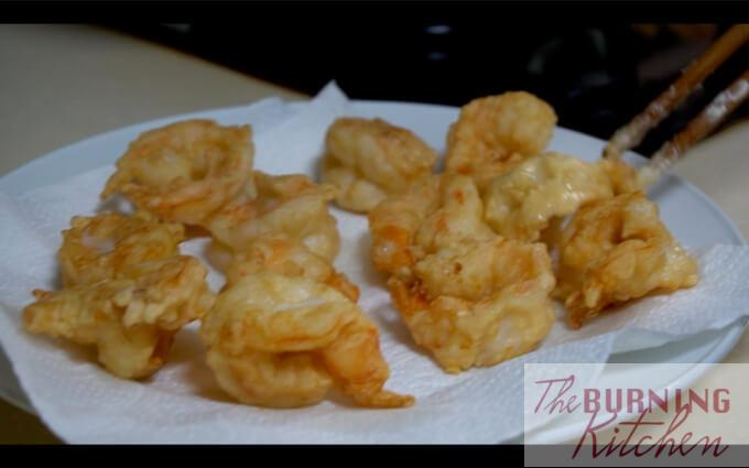 Drying fried battered prawns in paper towels