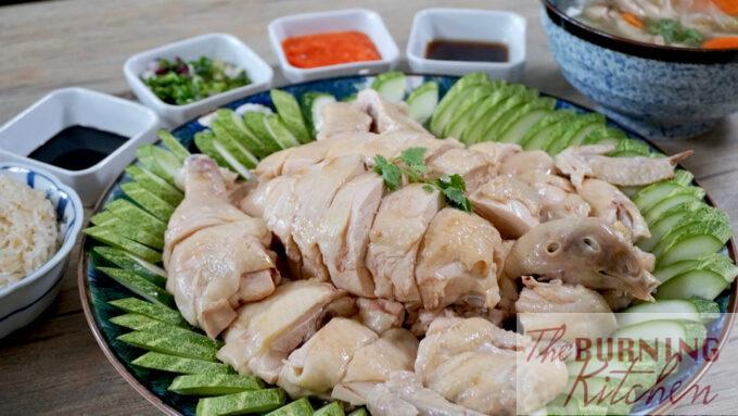 chicken rice chicken with sauces at the background and rice at the side