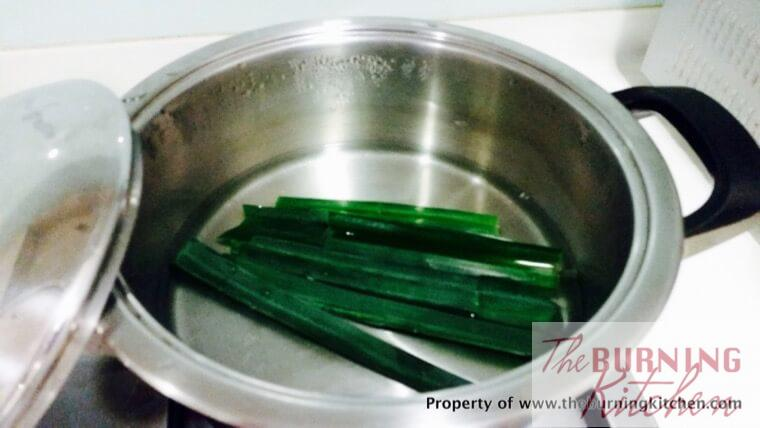 pandan leaves in boiling water in a metal pot