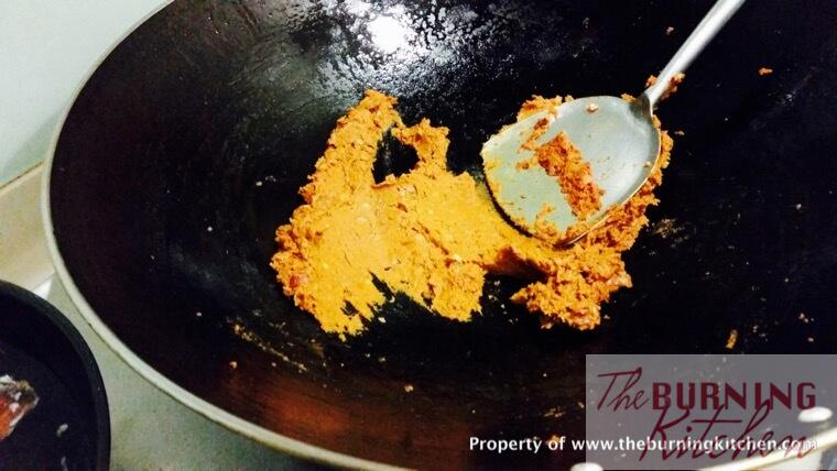 Mixing and frying curry paste in the wok