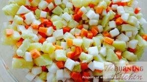 Diced carrots, potatoes and turnips on white plate