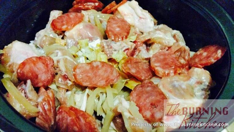 Adding chinese sausage, radish and chicken into claypot