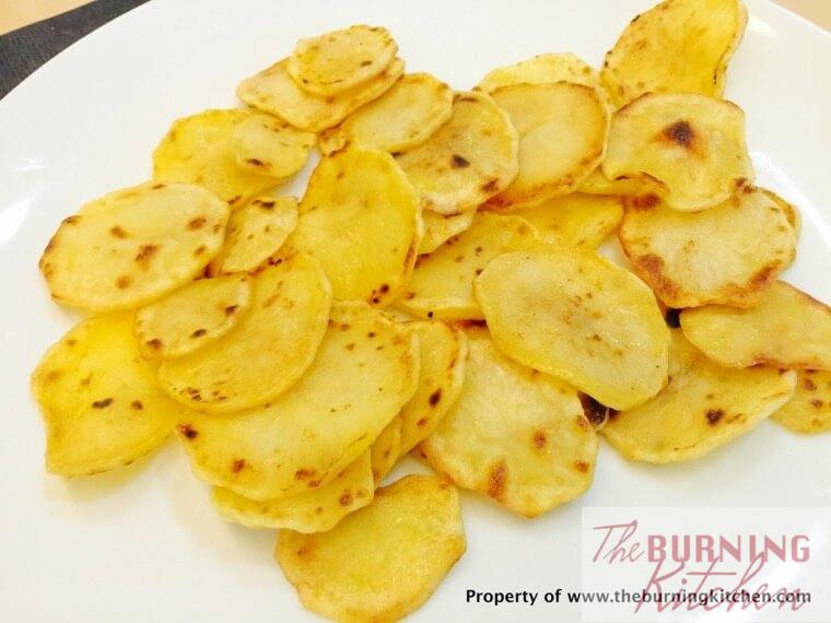 Pan fried potato slices on white plate