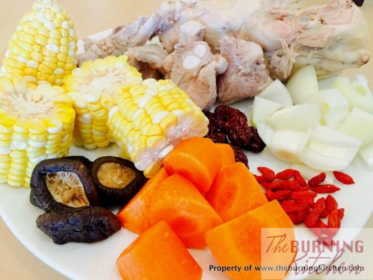corn, shiitake mushrooms, carrots, wolfberries, onions, pork ribs, red dates on a white plate