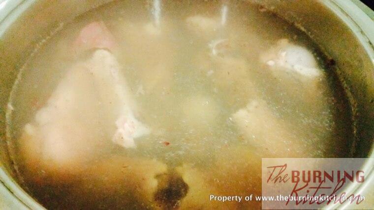 simmering chicken bones in water in stock pot