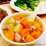 Potato Tomato Carrot Soup in white bowl