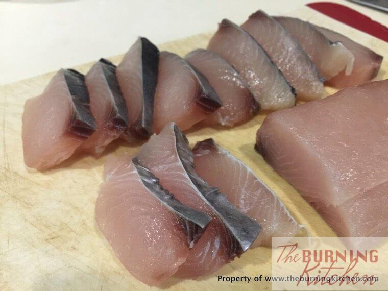 Sliced Batang fish on a cutting board