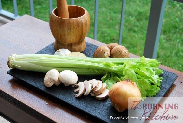 Ingredients for mushroom soup on black board