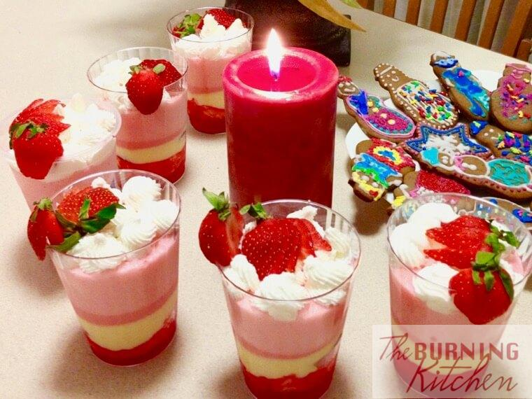 Strawberry Trifle cups with candle and gingerbread cookies