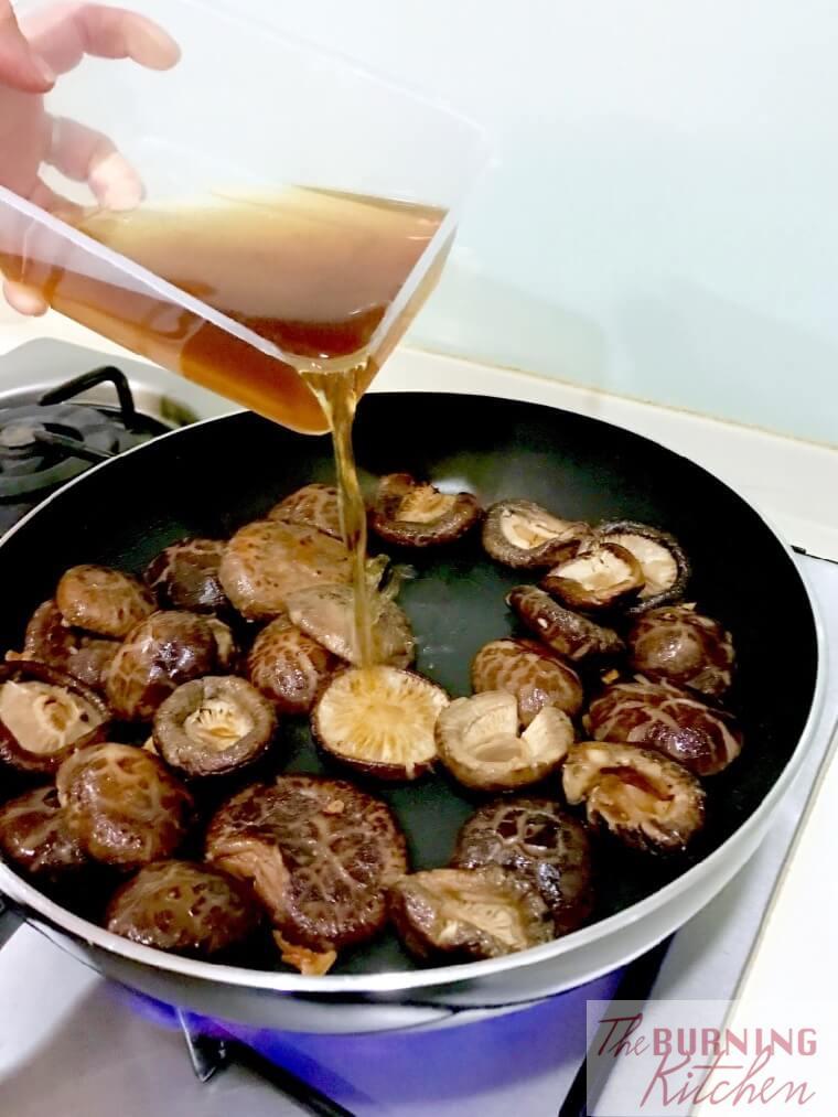 Adding mushroom water to braised mushrooms