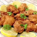 Shrimp Paste Chicken with lemon and coriander garnish on white plate