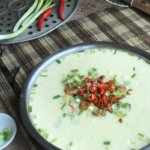 Chinese Steamed Egg with Minced Meat, garnished with red chillies and spring onions