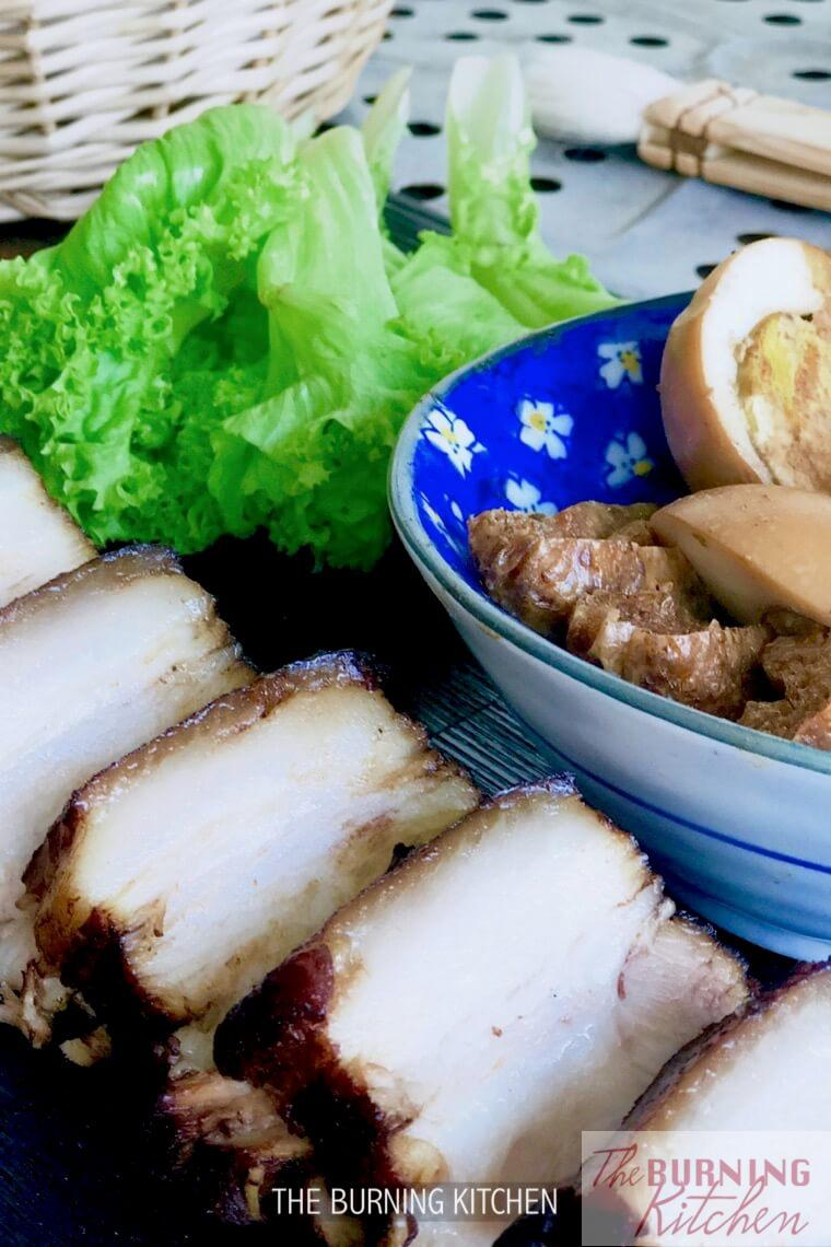 Braised Pork Buns, or Kung Bak Pao has generous portions of tender, melt-in-your-mouth braised pork belly slices served with freshly steamed leaf buns, crispy lettuce, eggs and firm tofu. So delicious! Learn how to perfect braised pork belly with this recipe. #braisedporkbuns #kungbakbao #chineselightsnack