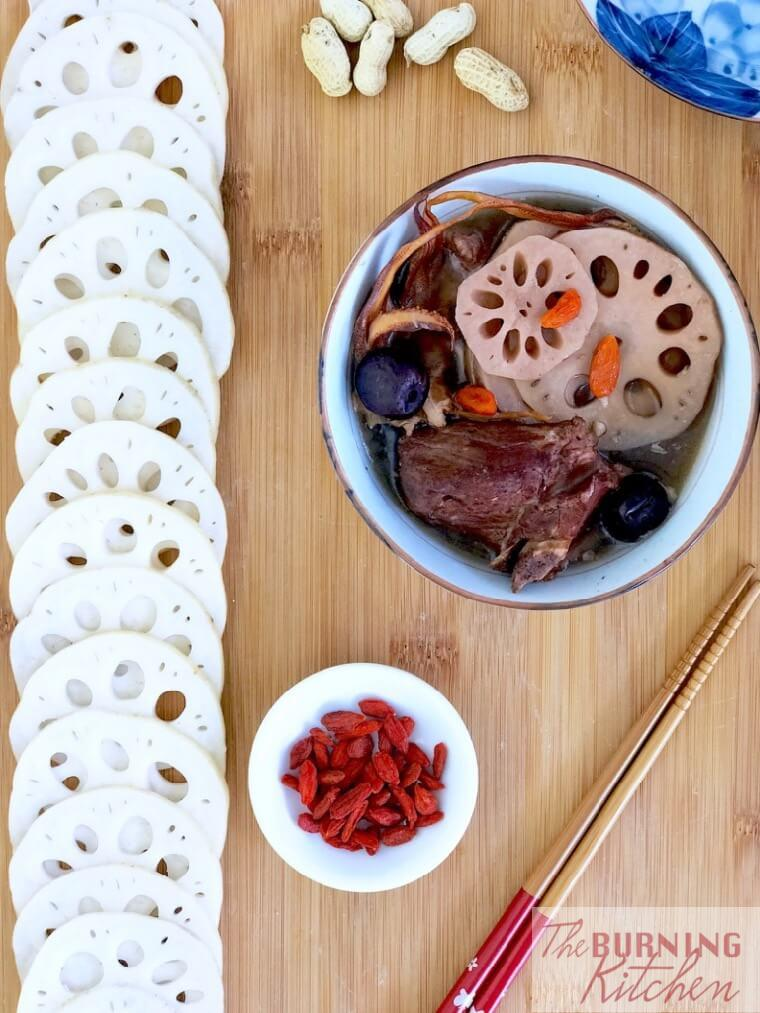 Lotus Root Soup in white bowl with wolfberries at the side