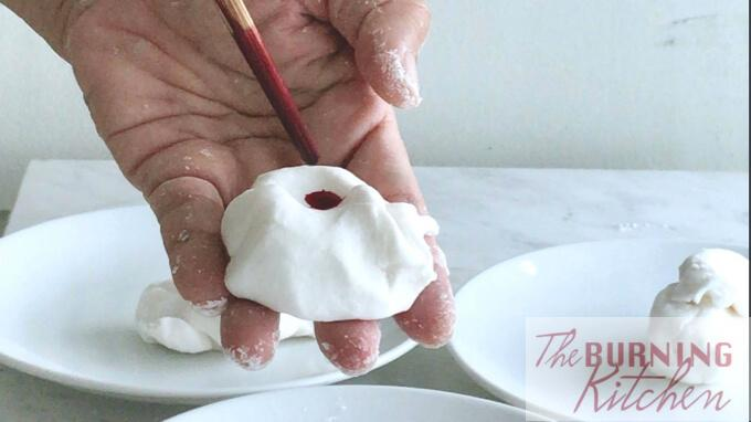 adding red food colouring into tapioca dough