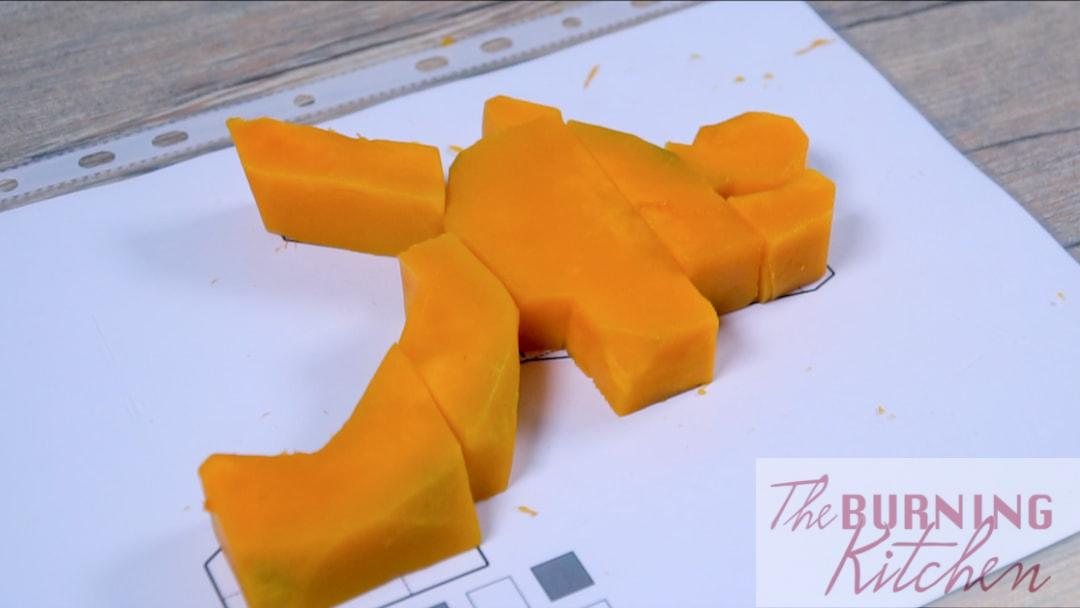 cutting the pumpkin according to the template