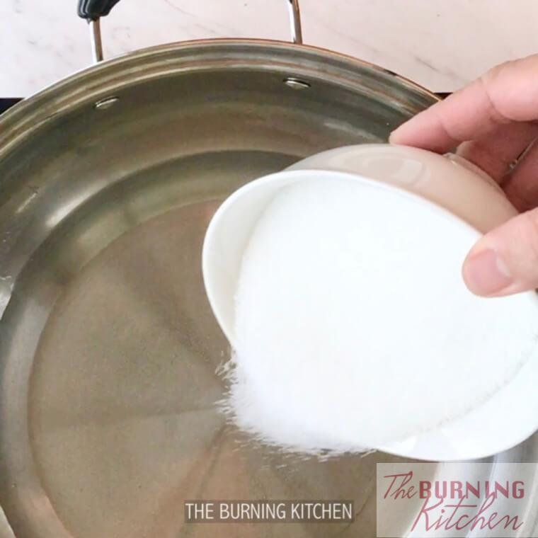 Pouring sugar into metal pot