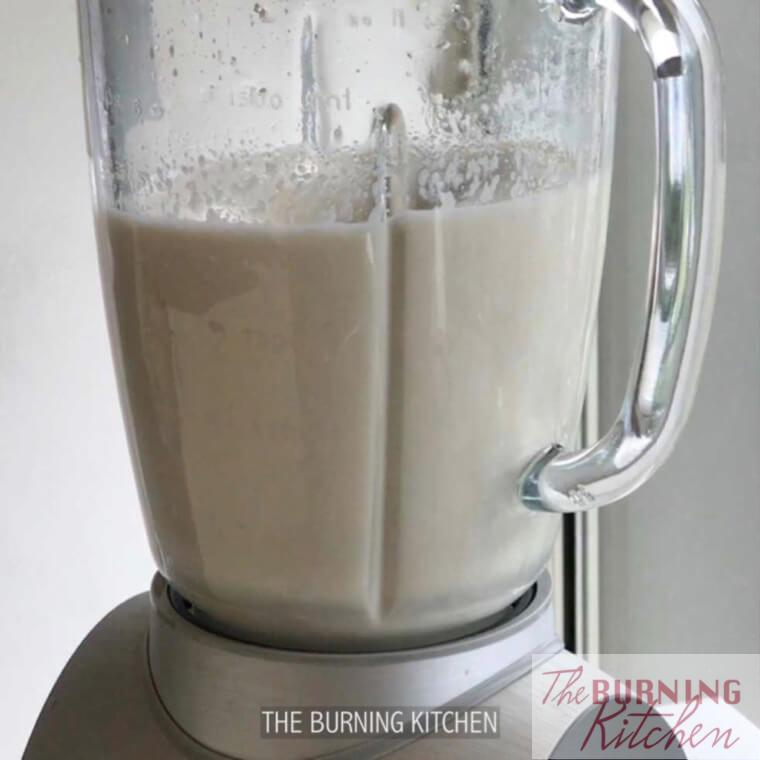 Blending soy beans and water in blender