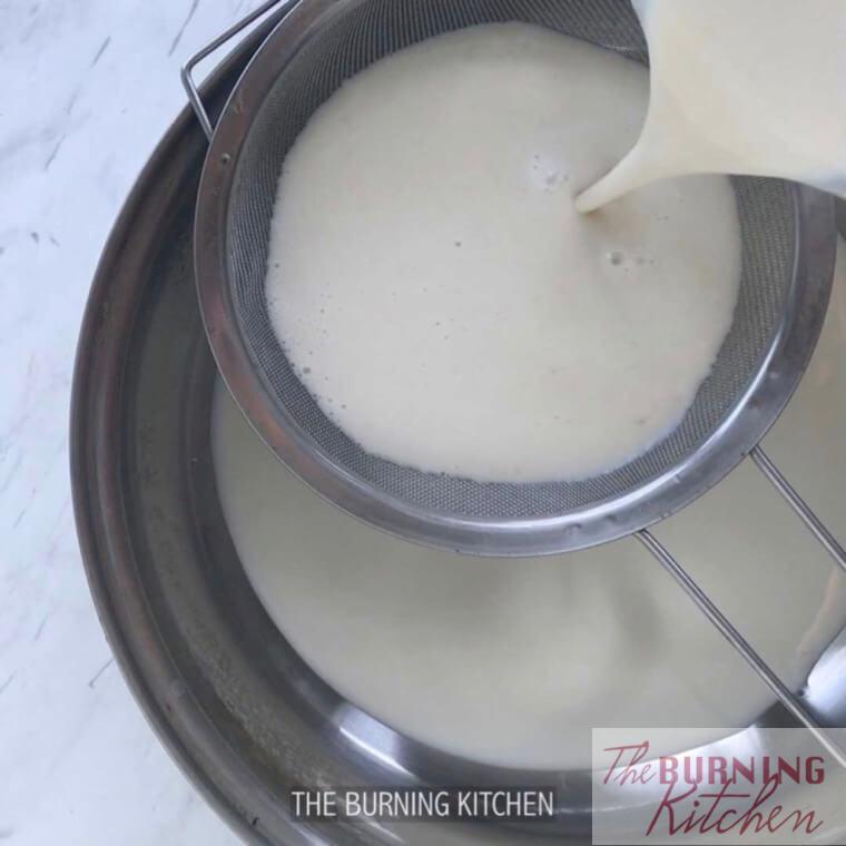 Sieving blended soy beans through strainer