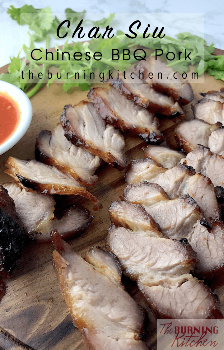 Row of char siew in the backgroun on chopping board