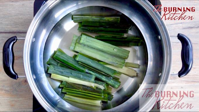 Pandan leaves and sugar boiling in hot water in metal pot