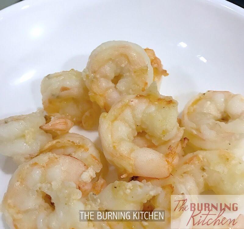 Stir fried prawns in white plate