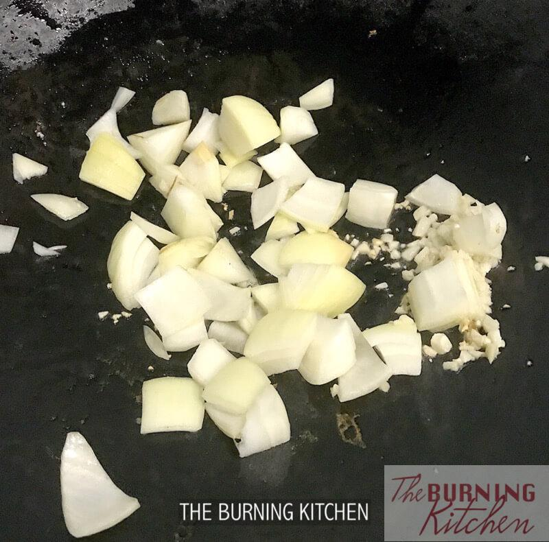 Stir frying onion in wok