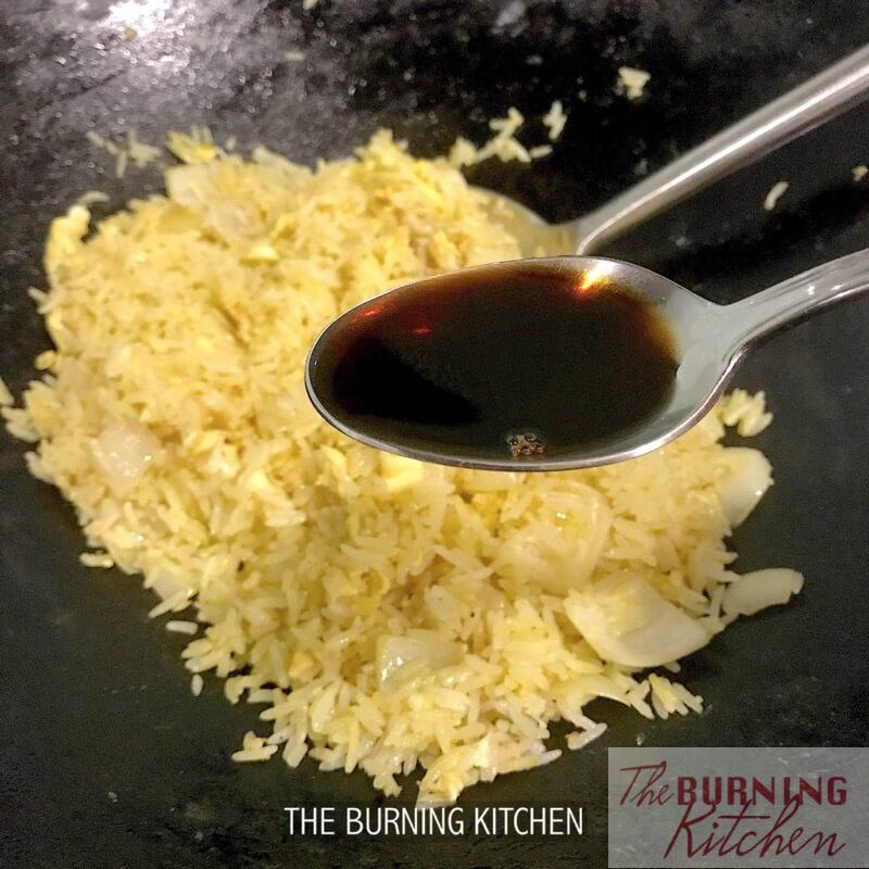 Adding fish sauce into fried rice