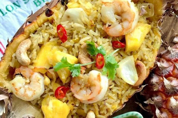 Thai Pineapple Fried Rice: With a plethora of flavours and textures ranging from sweet, savoury, spicy, crunchy to fluffy, this one-pan crowd-pleaser rice recipe has it all! Made using fresh pineapple and served in a beautiful pineapple boat.