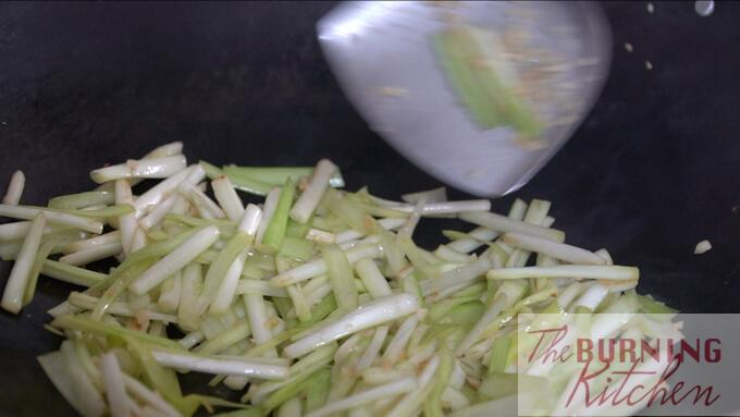 Stir-frying chopped chinese chives with garlic in wok
