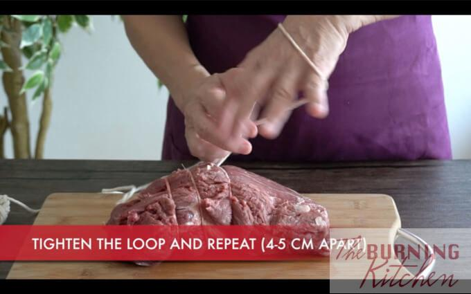 How to Tie a Roast: Tying a roast helps to retain a nice round shape during roasting, and also allows it to cook more evenly.