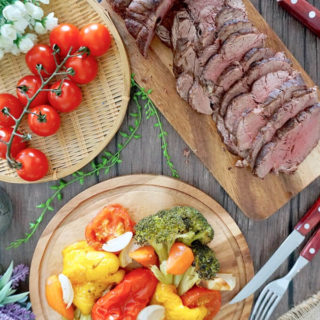 Roast Beef Tenderloin with cherry tomatoes and salad on the side