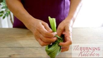 Pandan leaves being tied into a bundle