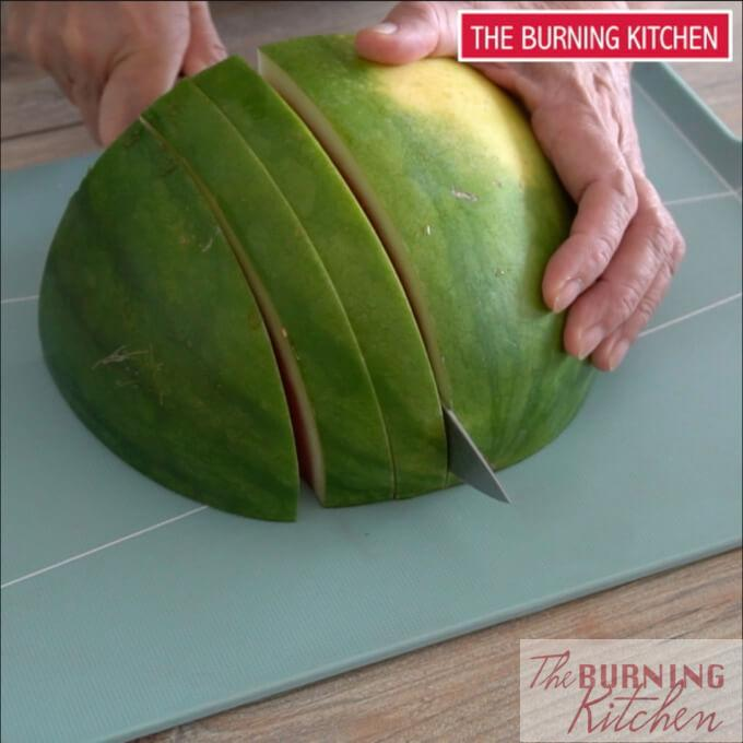 Slicing a watermelon into slices