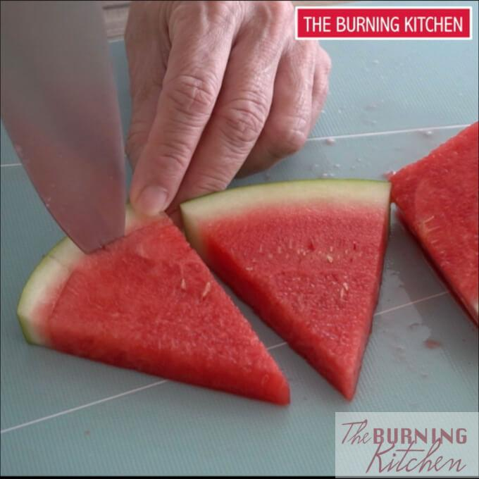Slicing through the skin of the watermelon slice