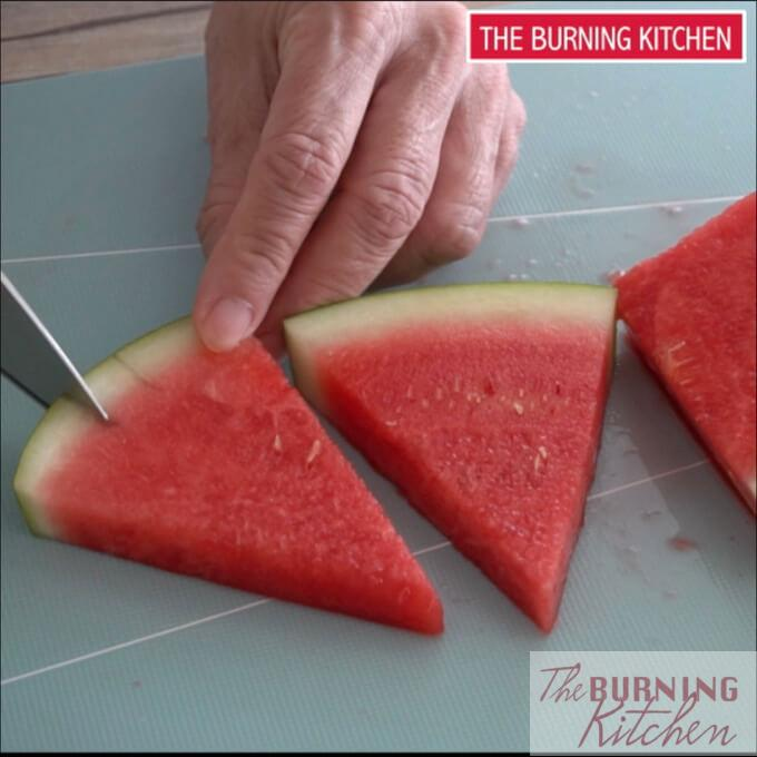 Making slits on the skin of the watermelon slice