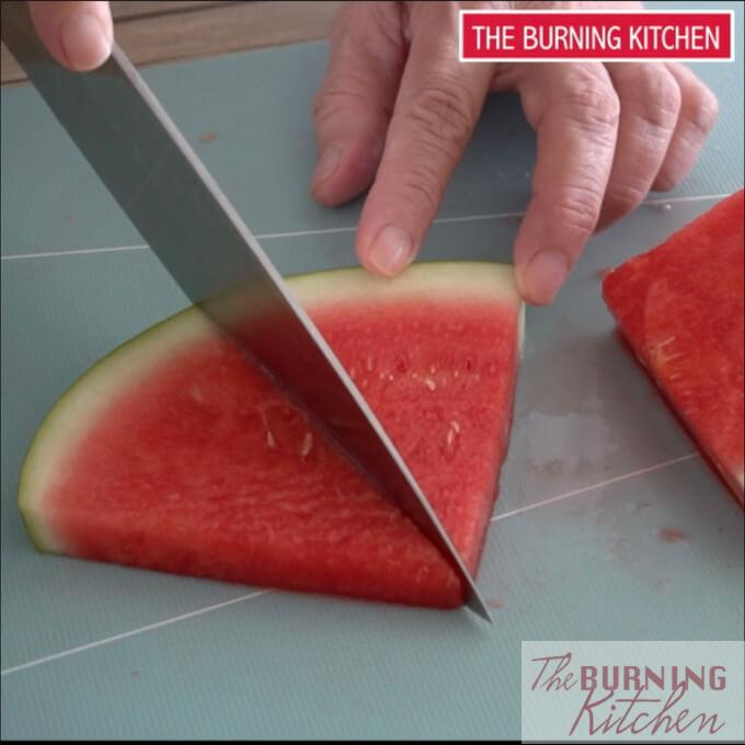 Halving a watermelon slice