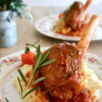 Braised Rosemary Lamb Shank: This lamb shank is braised in a hearty sauce of tomatoes, rosemary, onions and leek for 2 hours until fork-tender, and then served on a bed of mashed potatoes, and topped with cherry tomatoes on vine. A dinner party-worthy dish that requires only 45 minutes of active time!