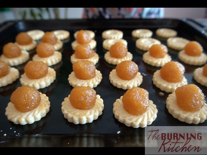 Pineapple tarts on a baking tray