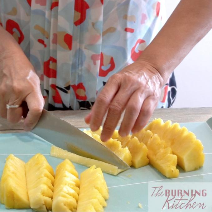 Cutting pineapple into chunks