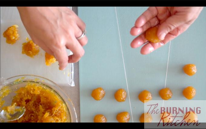 Pineapple jam rolled into small balls and put uniformly in rows on a board