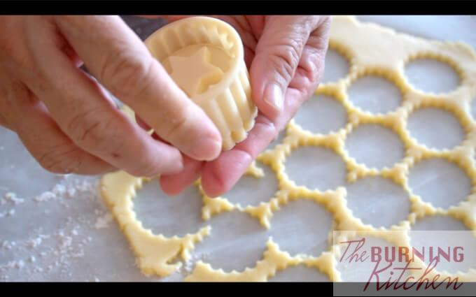 Cutting pineapple tart cookie shapes with cookie dough cutter