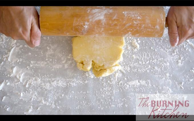 Rolling dough flat on baking paper