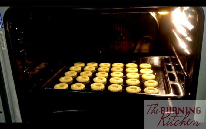 Baking pineapple tart cookie dough in oven