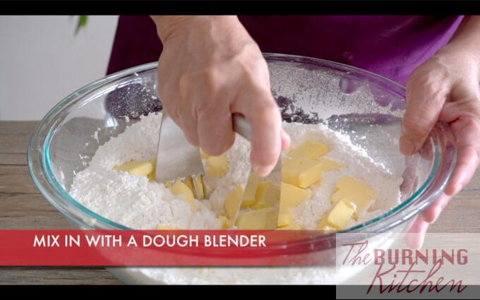 Kneading butter and flour mixture with dough blender