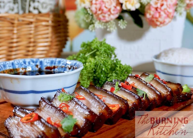 Sliced Assam Braised Pork Belly on wooden board