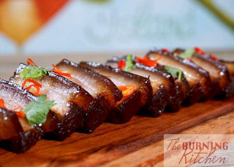 Sliced Assam Braised Pork Belly on wooden board