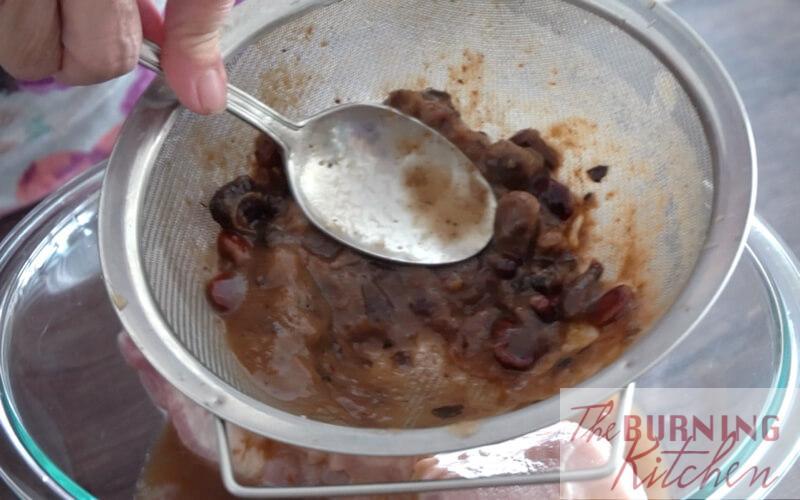 Mashing tamarind pulp through sieve