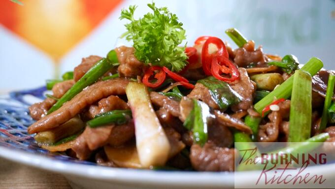 Beef with Ginger and Spring Onions on plate close up